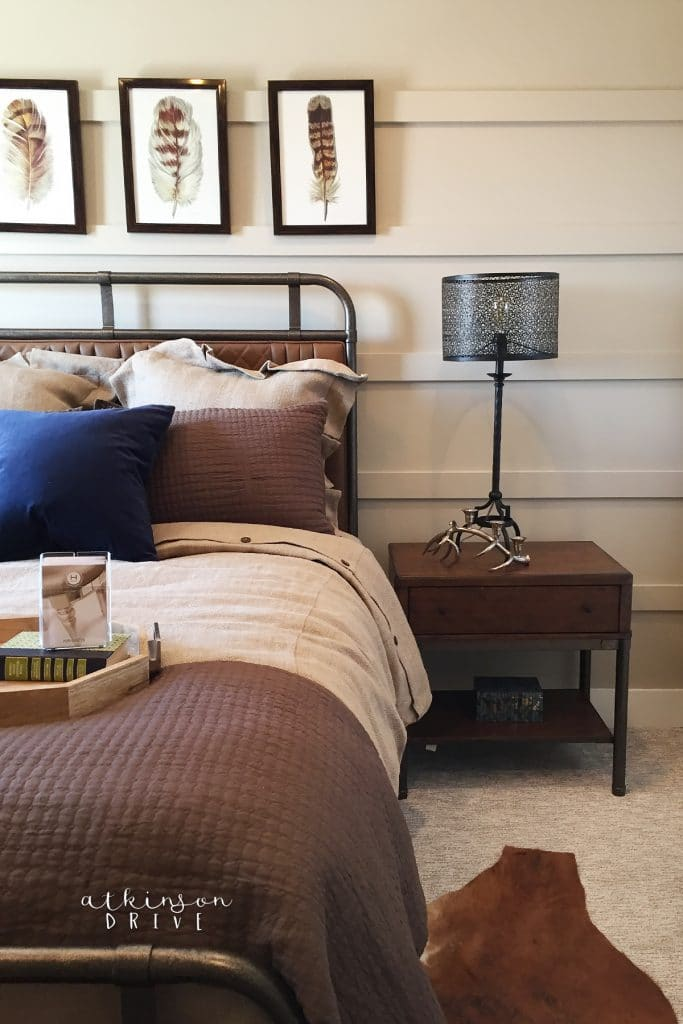 """This boys bedroom design will grow with your little one through their whole time at home! Use leather and metal to create a """"manly"""" space that won't go out of style!"""