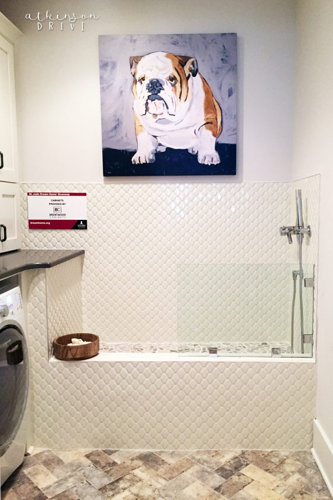 Every laundry room needs a herringbone tile floor and a gorgeous dog washing station!