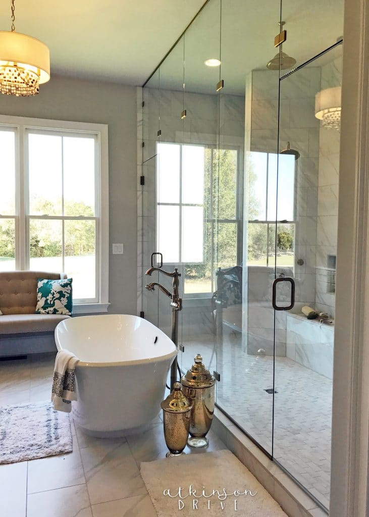 Large master bathroom with a modern pedestal tub and walk in shower for two /// Woodridge Home Tour by Atkinson Drive
