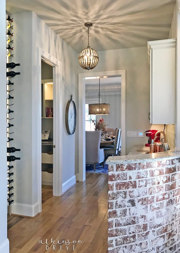 Casual butlers pantry with wine storage and a coffee bar /// Woodridge Parade of Homes Tour by Atkinson Drive