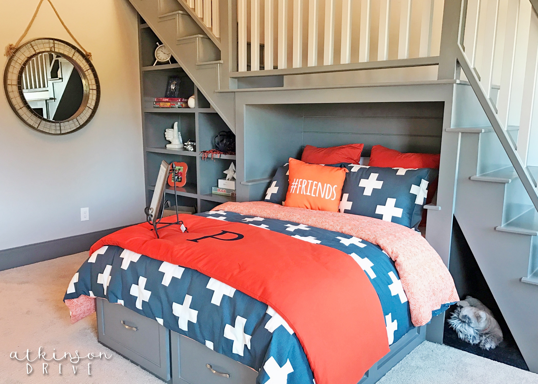 Navy blue and orange boys bedroom with a play loft /// Woodridge Parade of Homes Tour by Atkinson Drive