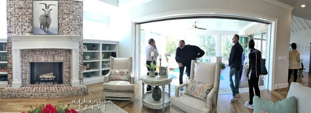 Traditional living room with a large folding sliding glass door /// Woodridge Parade of Homes Tour by Atkinson Drive