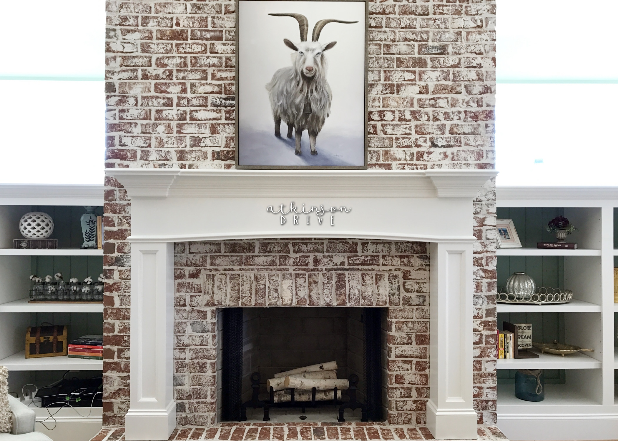 Traditional Brick Fireplace with Bookcase Surround /// Woodridge Parade of Homes Tour by Atkinson Drive Tour