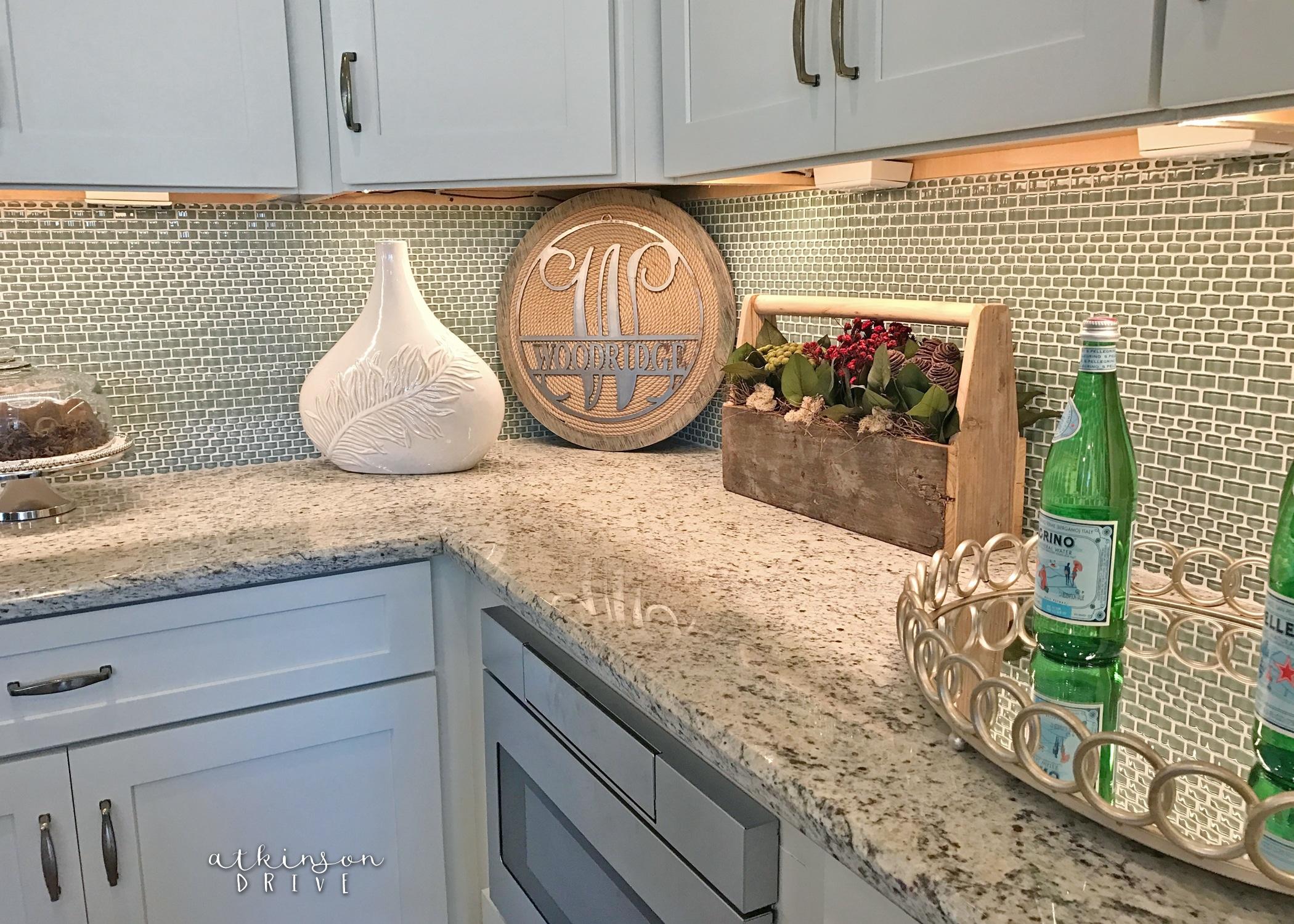 Blue Glass Kitchen Backsplash with White Shaker Style Cabinets /// Woodridge Parade of Homes Tour by Atkinson Drive