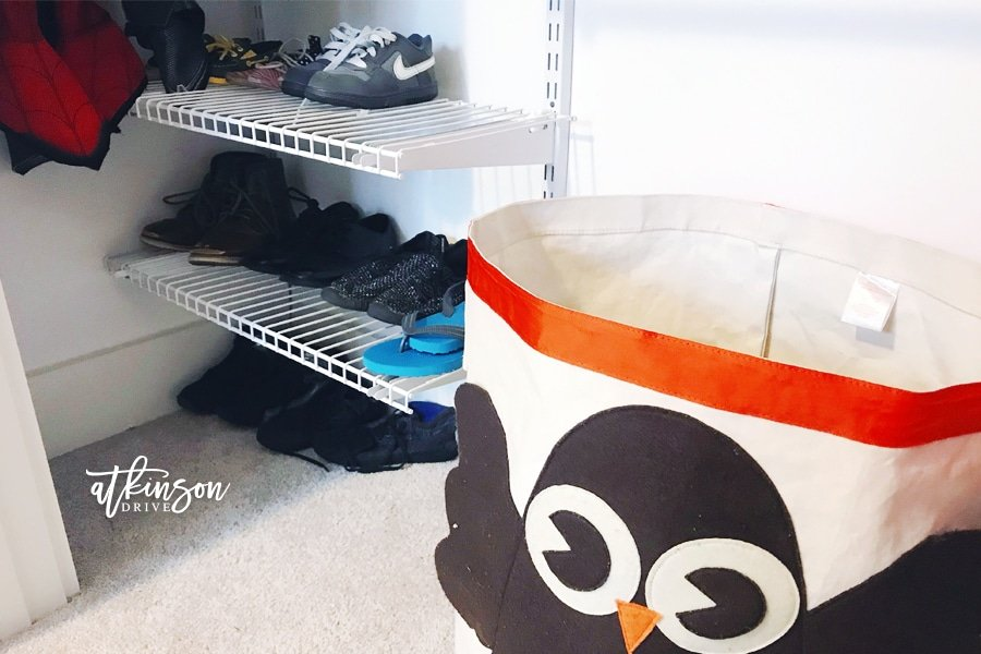 Even boys need organization ... that's why I set out to create this organized shared closet for brothers! Using a DIY closet system, we created a tiny but functional closet for boys who share a room. Click to see more!