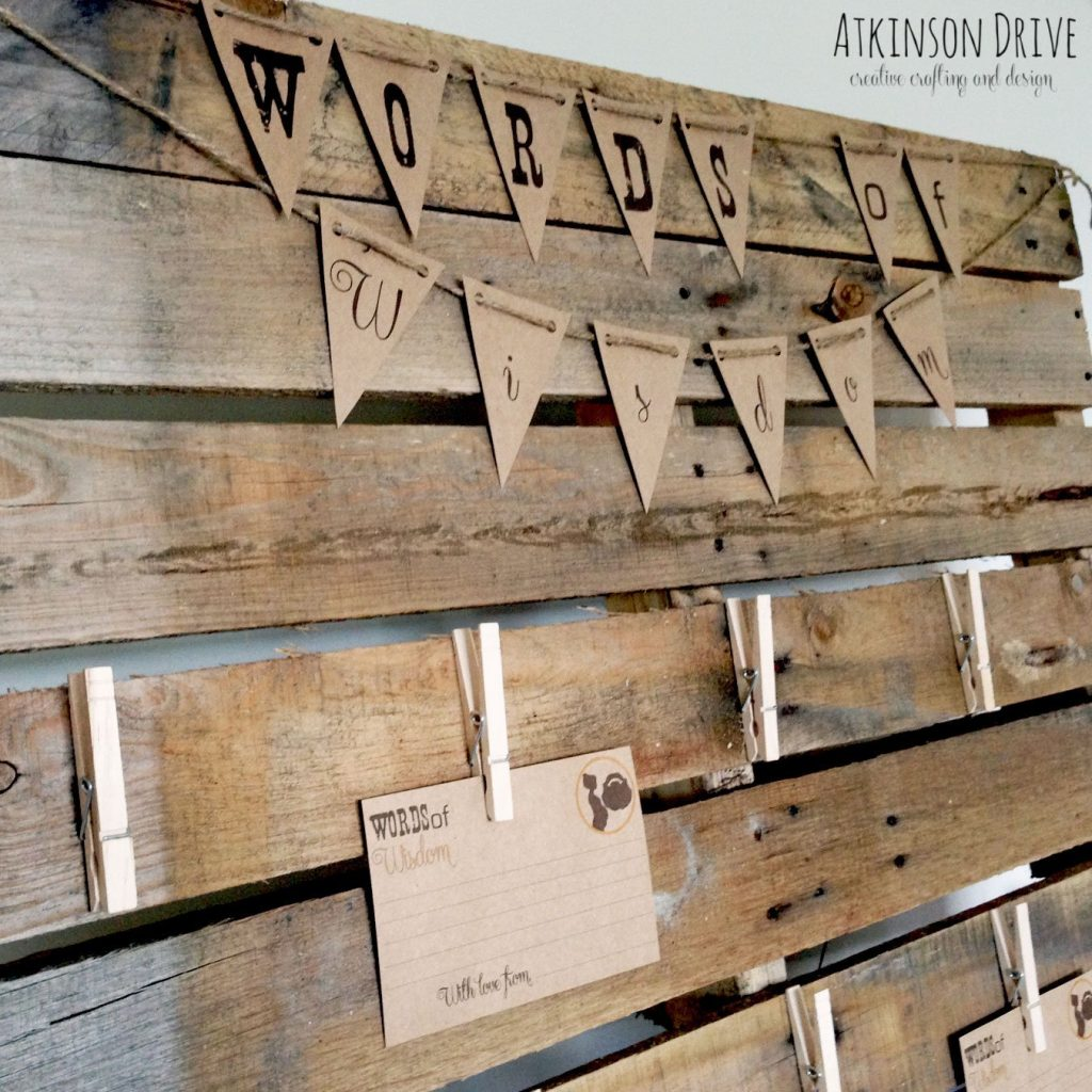 "Share ""Words of Wisdom"" for the parents-to-be with this rustic pallet advice station."