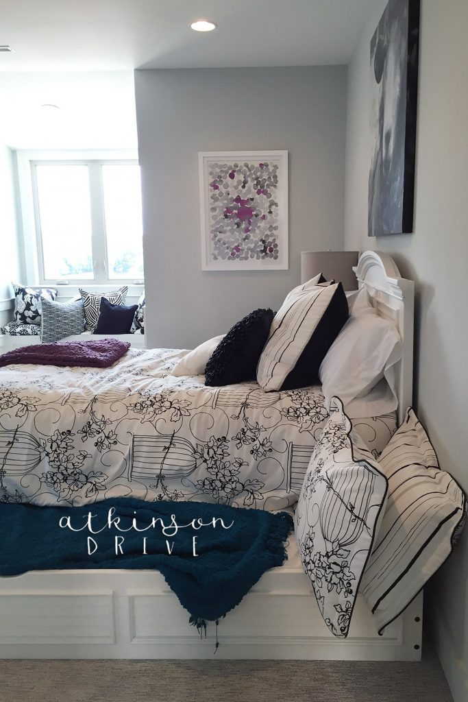Stylish bedroom with a double trundle bed and window seat
