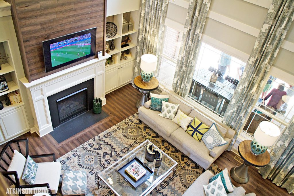 Home-a-Rama 2014: Comfortable family room with wooden fireplace focal wall   Atkinson Drive