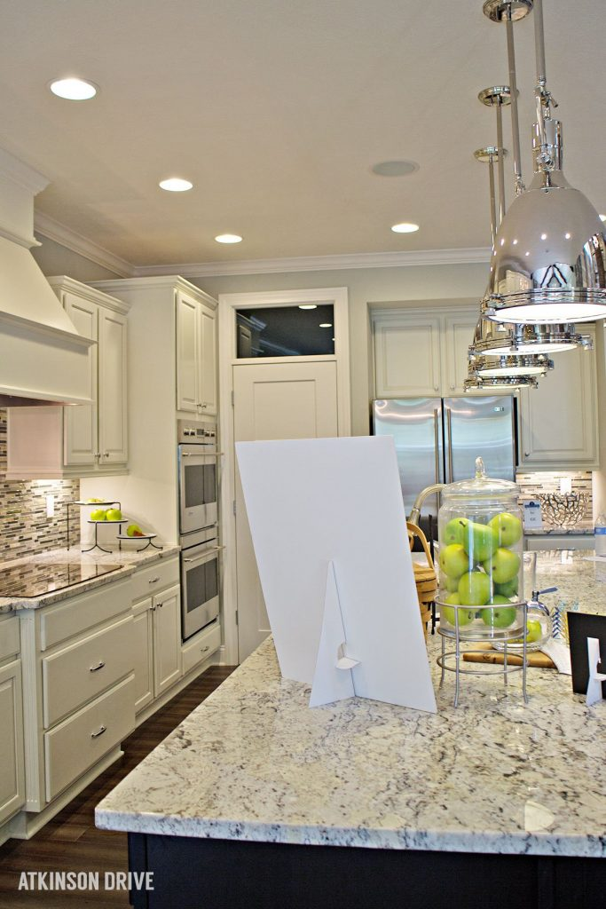 Home-a-Rama 2014: White kitchen with dark island and marble counters   Atkinson Drive