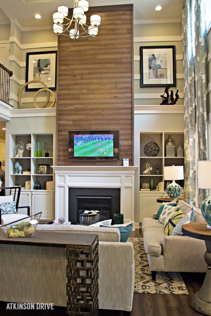 Home-a-Rama 2014: Cozy family room with floor-to-ceiling wood fireplace focal wall    Atkinson Drive