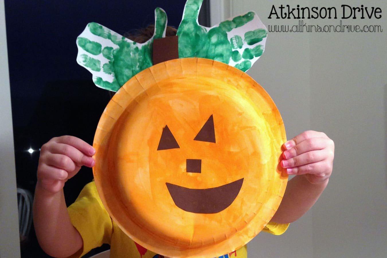 Handprint Paper Plate Pumpkins