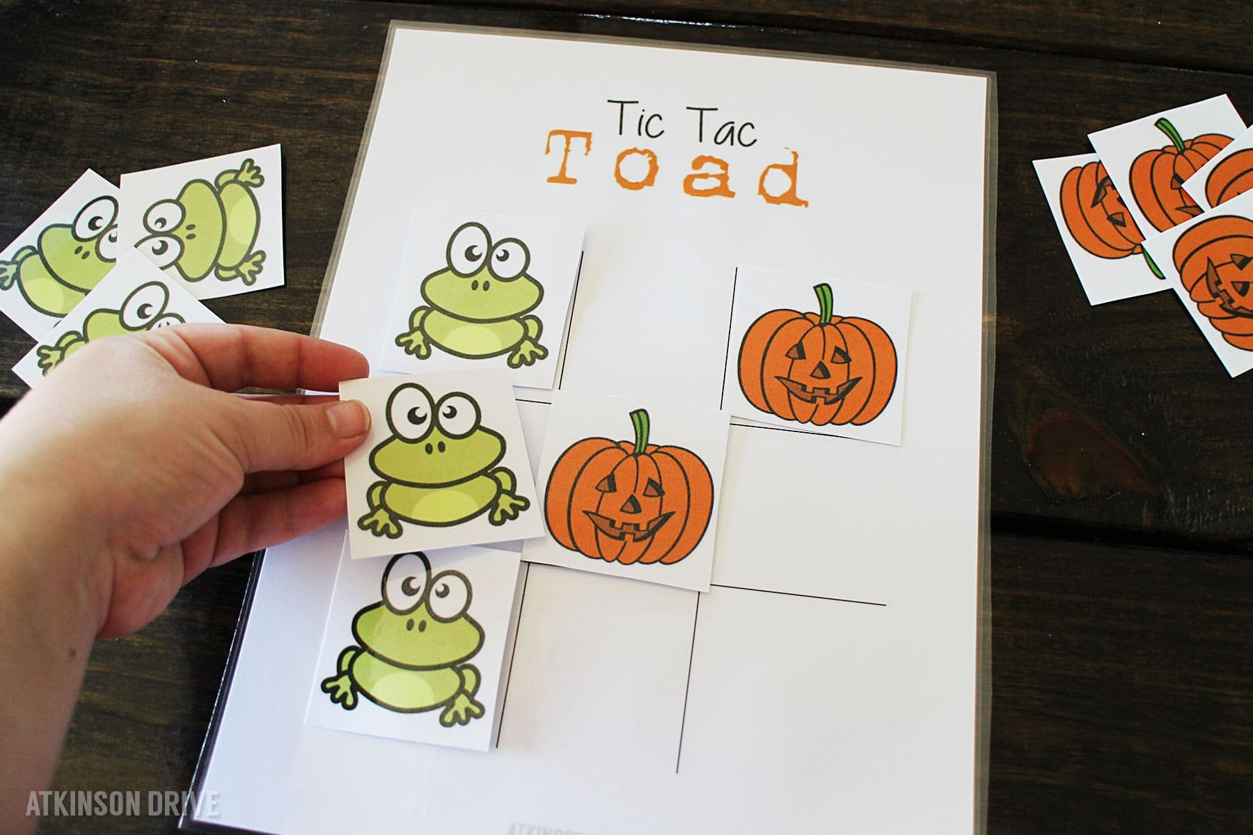 """Have some Halloween fun with your kids by printing out this game of """"Tic Tac Toad"""" (and bonus Pumpkin Patch Match game)!"""