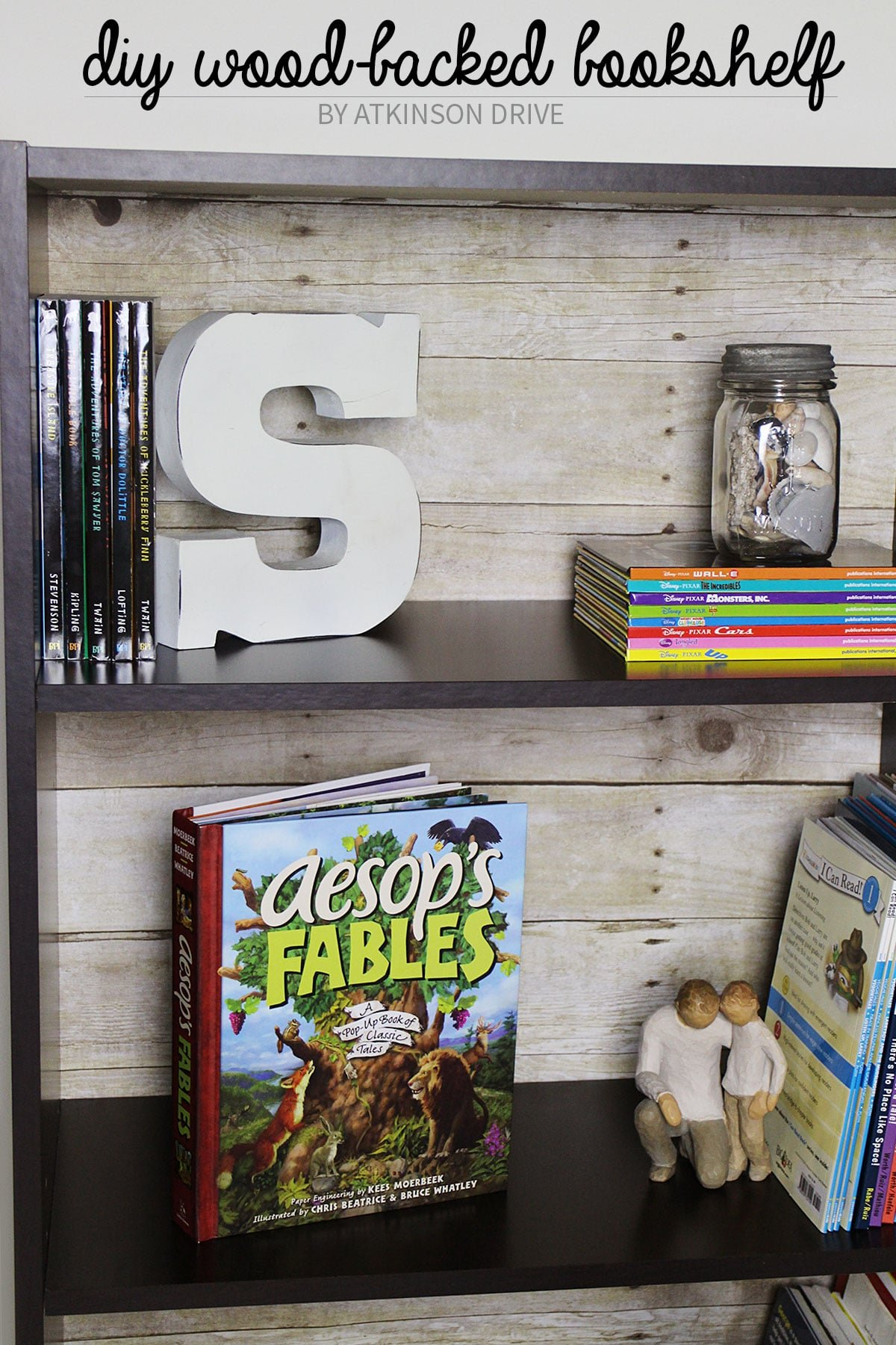 Create a faux wood-backed bookcase with a few simple tools, 5 minutes of your time, and only $10! /// by Atkinson Drive