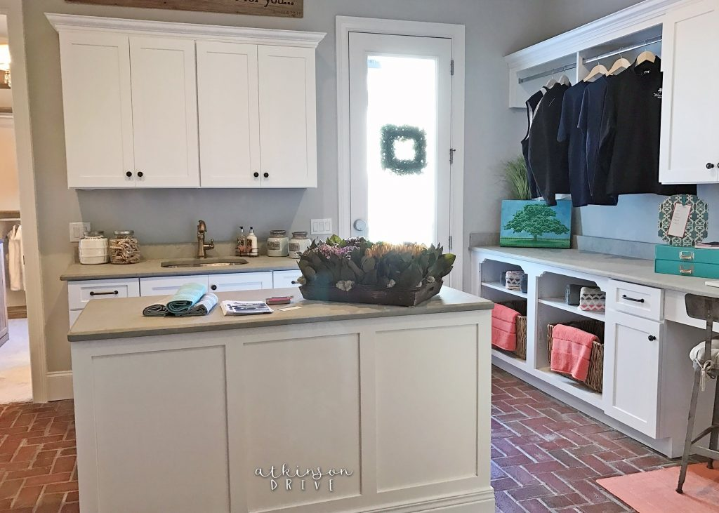 Large laundry room with a sink and folding island /// Woodridge Parade of Homes Tour by Atkinson Drive