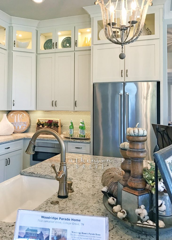 White kitchen with shaker style cabinets reaching the ceiling /// Woodridge Home Tour by Atkinson Drive