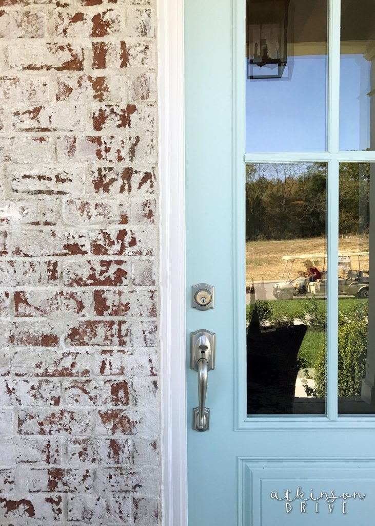 Whitewashed Brick Exterior with a Light Blue French Door /// Woodridge Parade of Homes Tour by Atkinson Drive