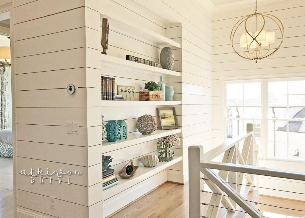 Stairwell with shiplap detail and built in book storage /// Woodridge Parade of Homes Tour by Atkinson Drive